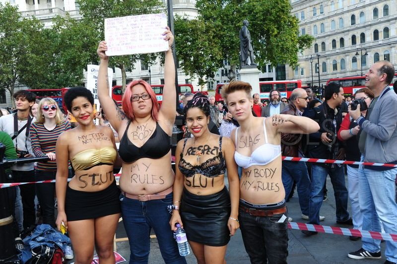 "Ugly feminists with the word ""Slut"" written on their bodies."